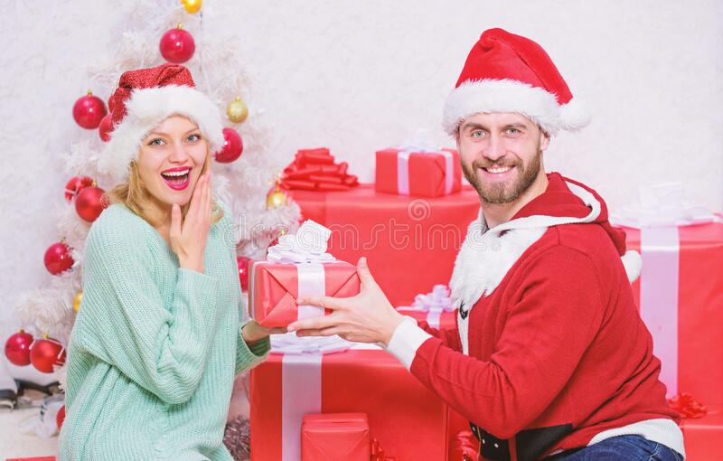 Gift to beloved. Couple in love happy enjoy christmas holiday celebration with gifts. Loving couple cuddle smiling while stock photography