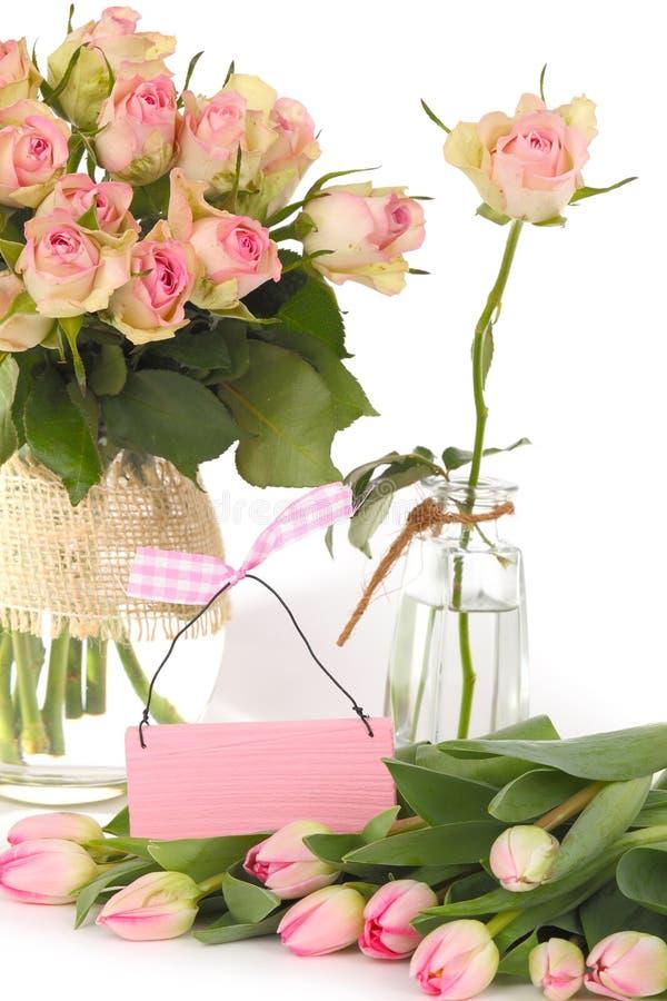 Gift voucher, flowers stock photos