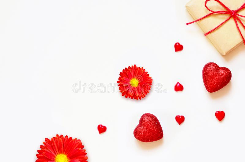 A gift on a white background with decorations. The concept of the St. Valentine`s day, weddings, birthday and other. A gift on a white background with box and royalty free stock images