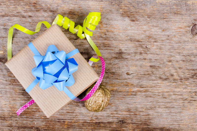 Gift on wooden background royalty free stock photography