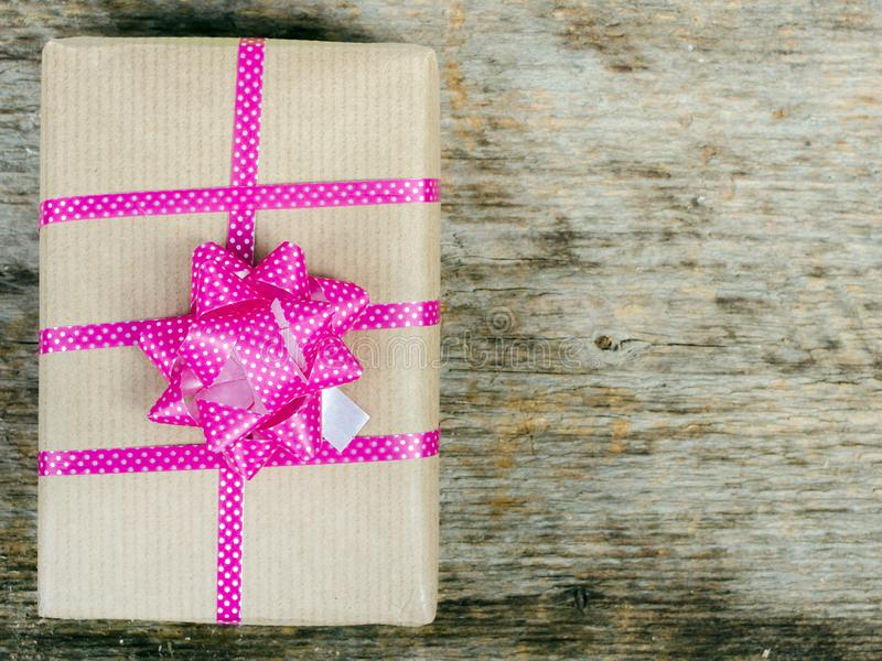 Gift on wooden background stock photography