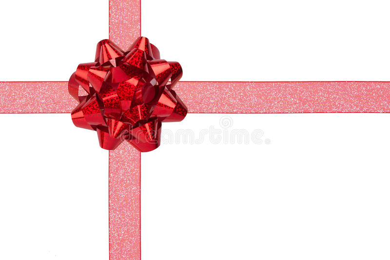 Gift Wrap with Red Sparkly Ribbon and Bow. Gift Wrap with Red Sparkly Ribbon and Red Shiny Bow Isolated stock image
