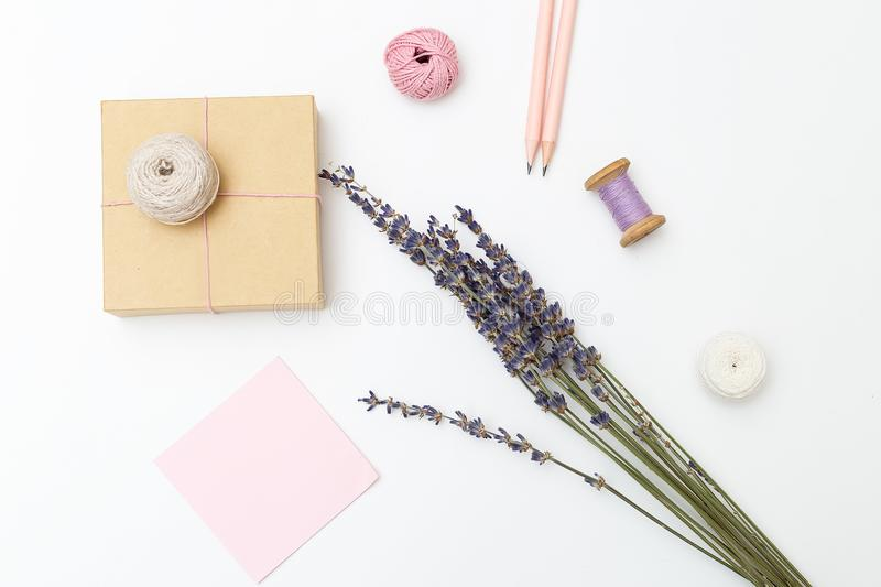 Gift Wrap. Threads, gift box and bouquet of lavender on a white. Background stock photography