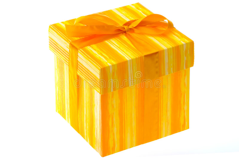 Gift wrapped box. A gift wrapped present on an isolated white background stock photography