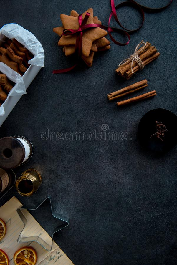 Gift wrapping of Christmas star shaped gingerbread cookies. stock photo