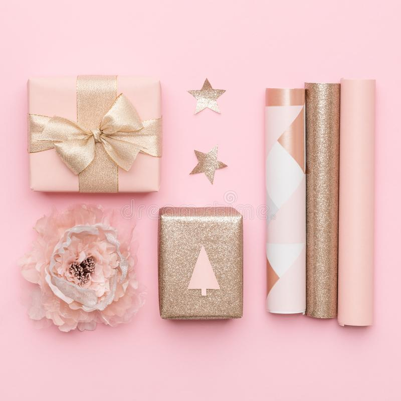 Gift wrapping. Pink and gold nordic christmas gifts isolated on pastel pink background. royalty free stock images