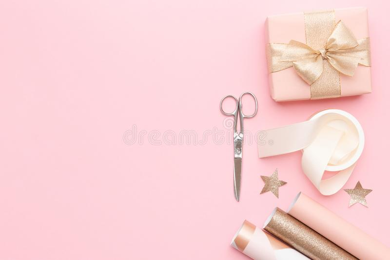 Gift wrapping. Pink nordic christmas gifts on pastel pink background. stock image