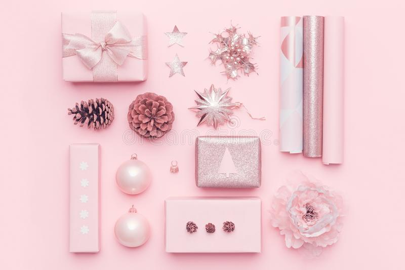 Gift wrapping. Pink nordic christmas gifts isolated on pastel pink background. Wrapped xmas boxes. stock image