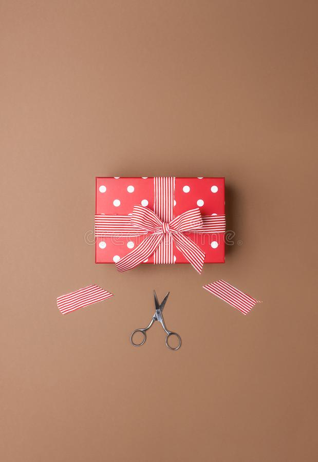 Gift wrapping with a red gift box and ribbon cutting. Presents royalty free stock photo