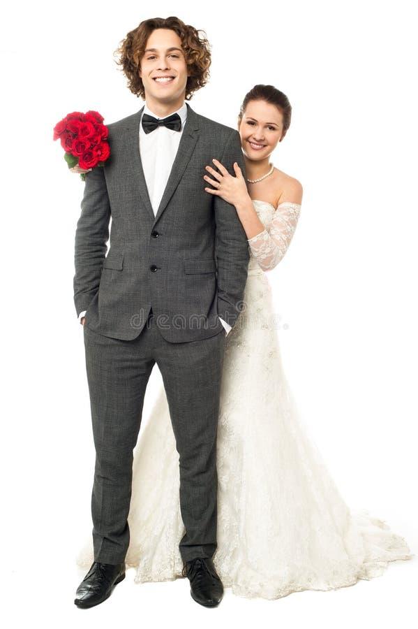 Gifta sig par, bruden och brudgummen arkivfoto
