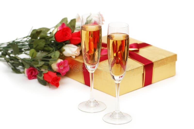 Giftboxes et champagne images libres de droits