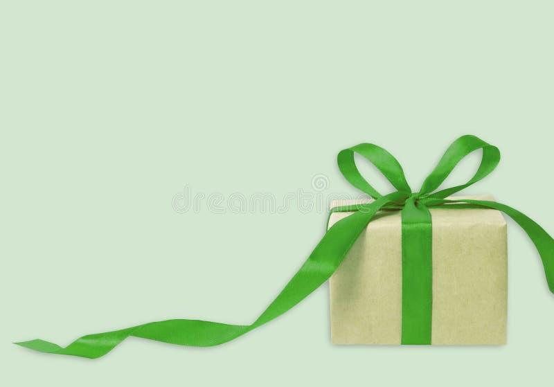 Giftdoos tegen bokehachtergrond Aanwezige vakantie Feestelijke gift royalty-vrije stock foto