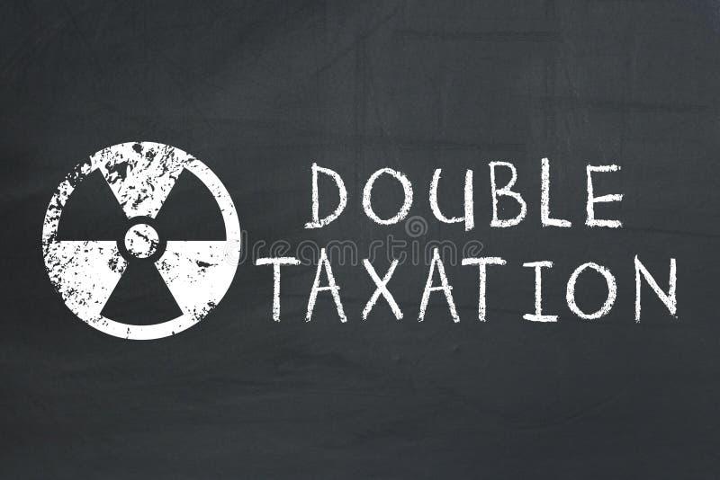Giftige belasting Dubbele belastingheffingsconcept stock foto's