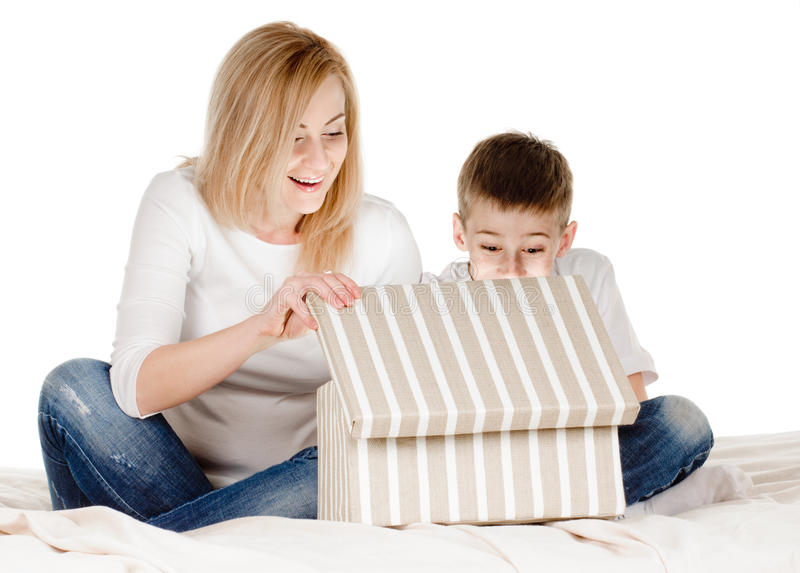 Gifting box. Mother and son with gift in box on white royalty free stock image