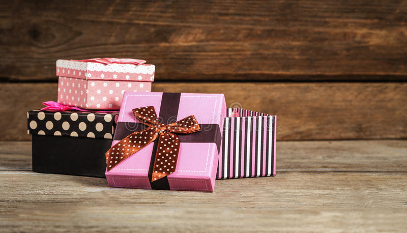 Download Gifts In Beautiful Boxes On A Wooden Stock Photo - Image: 83720354