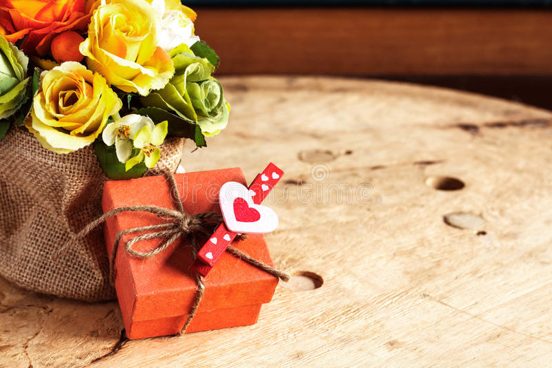 Gifts and bouquets on wooden. Gifts and bouquets of flowers on the wooden stock photo