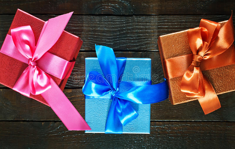 Gifts. Box for present with ribbons on a table stock photography