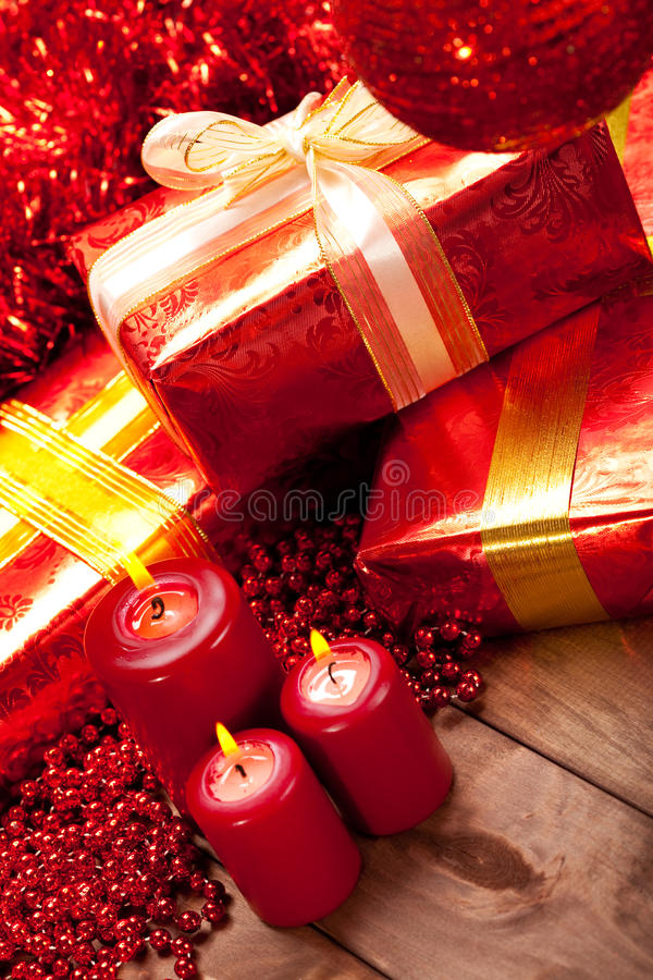 Gifts and candles - christmas decoration royalty free stock photo
