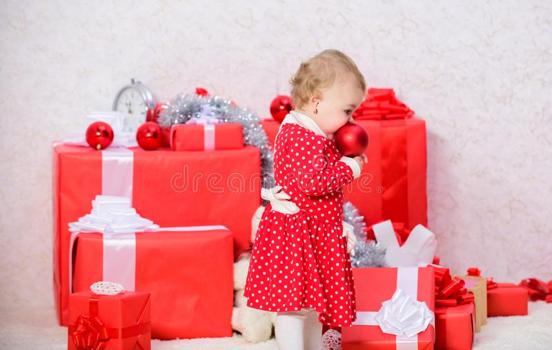 Gifts for child first christmas. Little baby girl play near pile of gift boxes. Family holiday. Christmas activities for. Toddlers. Christmas gifts for toddler royalty free stock images