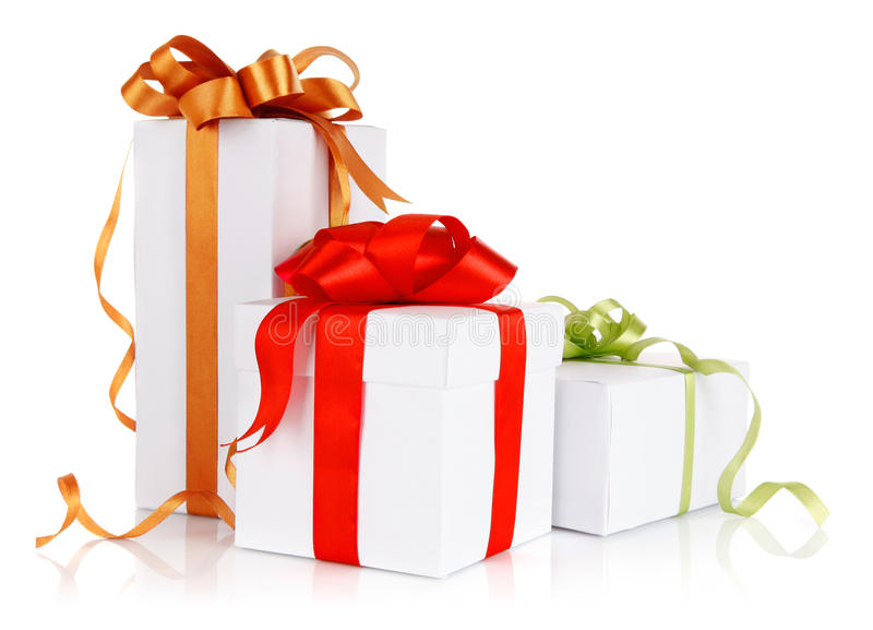 Gifts with coloured bow. Isolated on white background stock photo