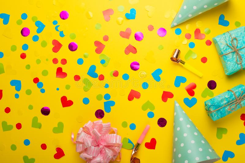 Gifts with confetti for the holiday. Top view with an empty place for inscription or advertising. Gifts with confetti for the holiday. Top view with an empty royalty free stock image