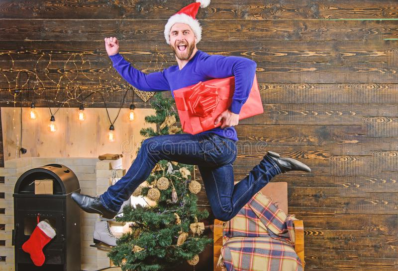 Gifts delivery. Man santa hat hurry to deliver gift on time. Spread happiness and joy. Bearded guy in motion jump stock images
