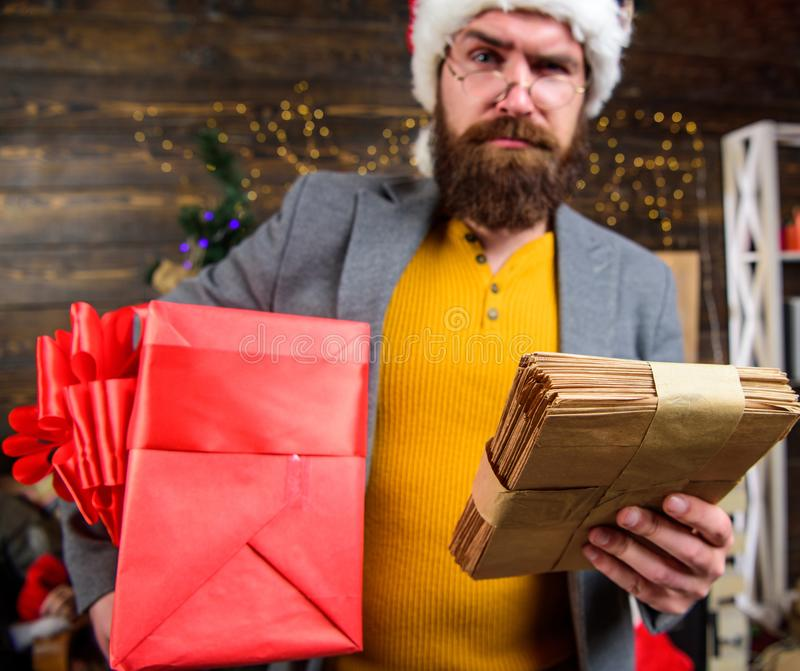 Gifts delivery service. Post for santa claus. Man bearded hipster wear santa hat hold bunch of letters and gift box stock images
