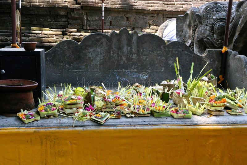 Gifts and gifts man-made and natural in a temple on Bali Island in Indonesia stock image