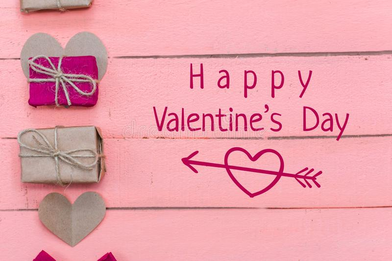 Gifts and hearts on pink wooden background stock images