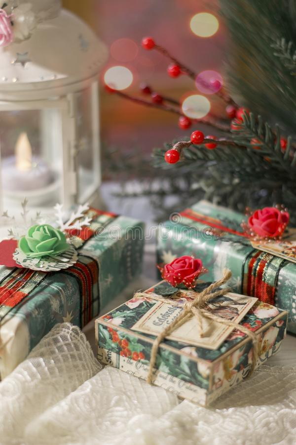 Gifts for the holidays.Christmas gifts.in anticipation of the new year and Christmas. Photo wrapped gifts in anticipation of the new year and Christmas royalty free stock image