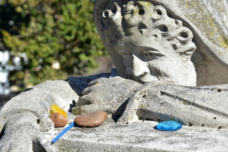 Gifts for the lady. An old tradition of leaving small gifts for the dead is practiced here for the weeping lady, a famous grave marker in West Virginia. Many royalty free stock images