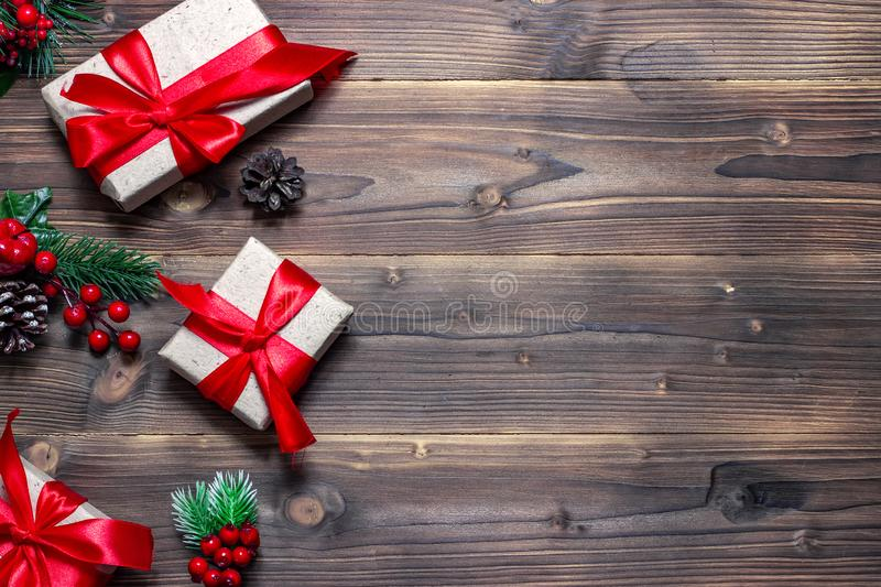 Gifts for New Year and Christmas on the old wooden background. Top view with copy space stock photos