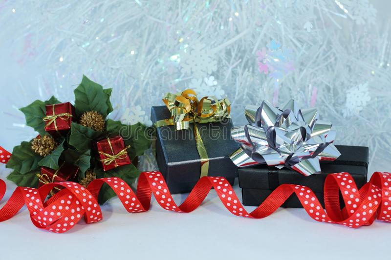 Gifts with shiny bows on a Christmas party decor stock images