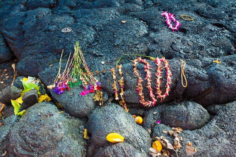 Gifts to Goddess Pele. Gifts left for the goddess of volcanoes Pele on molten lava, Big Island, Hawaii royalty free stock photo