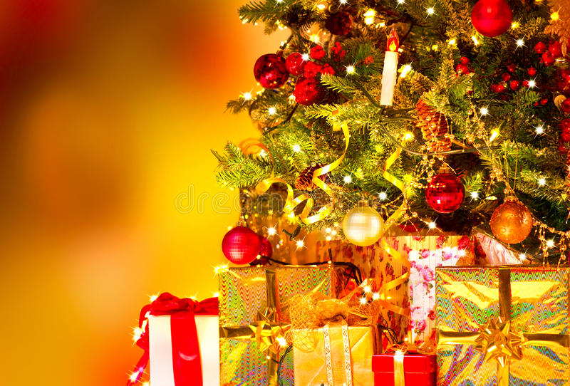 Gifts under the Christmas tree royalty free stock images