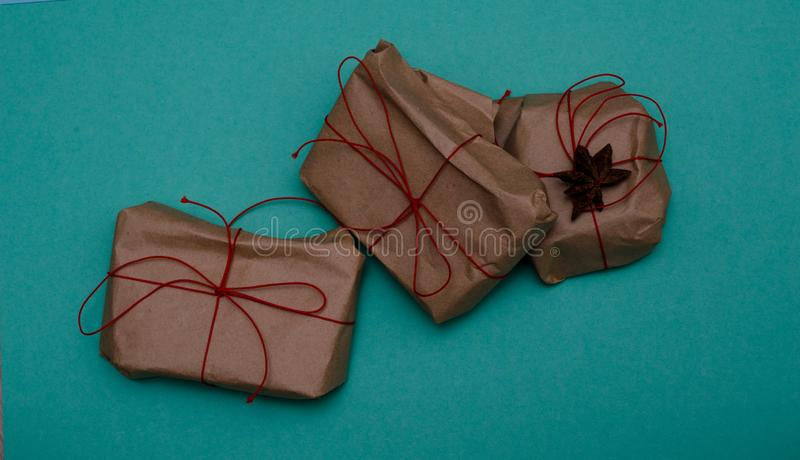 Gifts wrapped with paper on blue background stock image