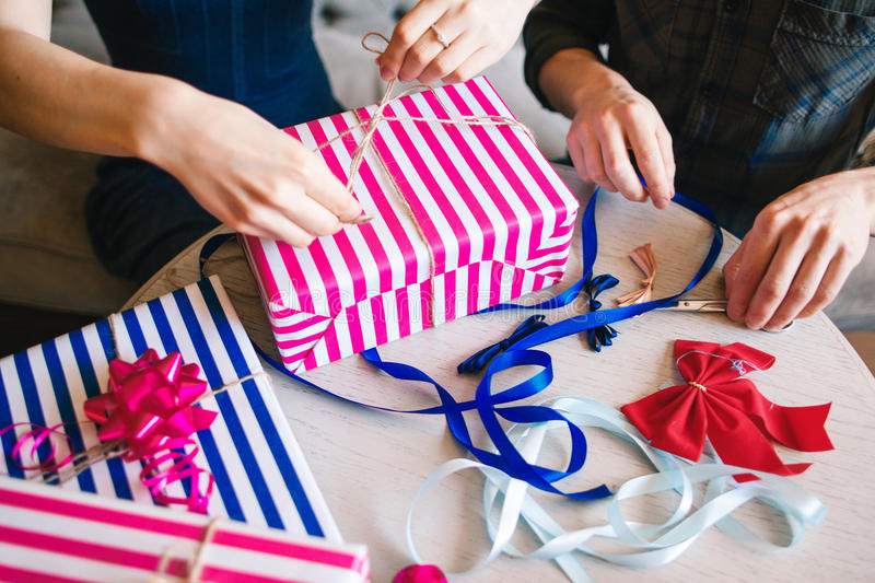Gifts wrapping close-up. Self made presents stock photo