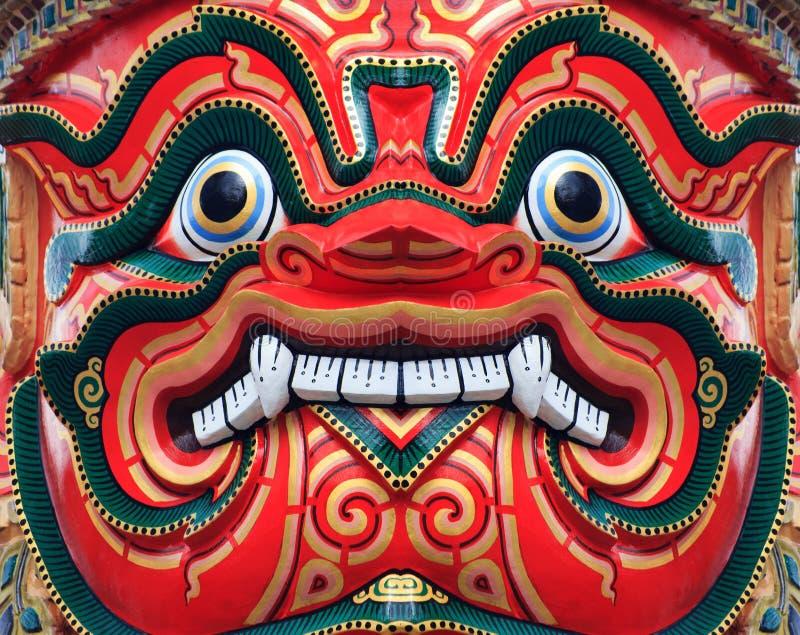 Gigante tailandês antigo da face vermelha foto de stock