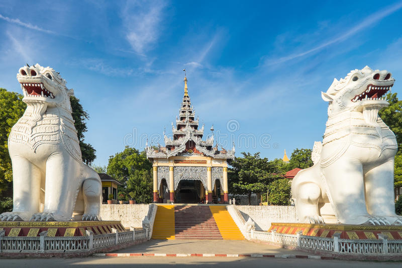 Gigantic Bobyoki Nat guardian statues at Mandalay Hill. Myanmar. Gigantic Bobyoki Nat guardian statues at central entrance gate to Mandalay Hill Pagoda complex stock photo