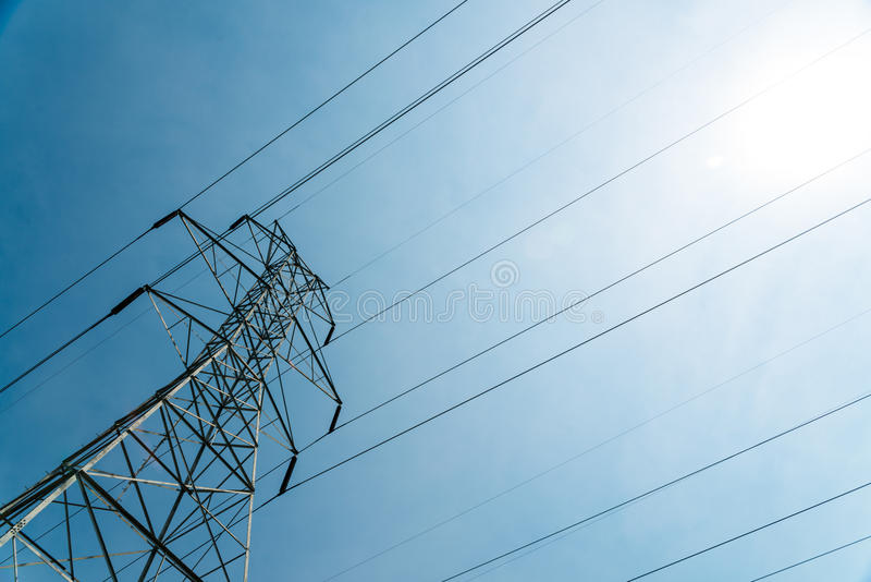 Gigantic High Voltage Electical Tower Phone Tower at Angle on Sunny Day. This is a sharp picture of a cell phone tower with wires peering off at an angle into royalty free stock photography