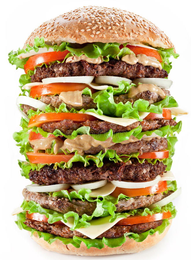 Gigantic hamburger. On white background stock images
