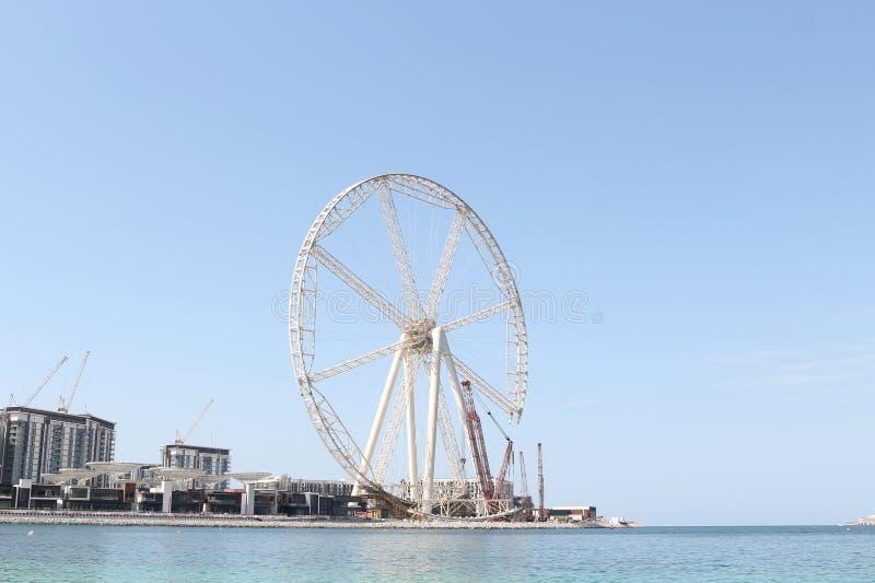 Gigantyczny ferris koło ono buduje blisko Dubaj Marina zatoki Listopad 23, 2017 Dubaj, UAE 2009 amerykańskiego auto odwracalnego  fotografia royalty free