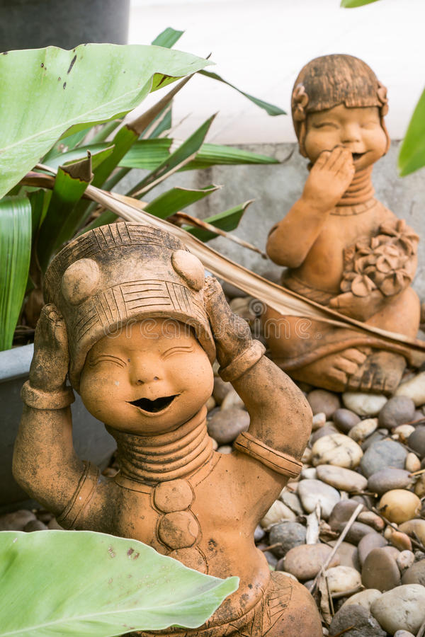 Giggle kids statue royalty free stock photos