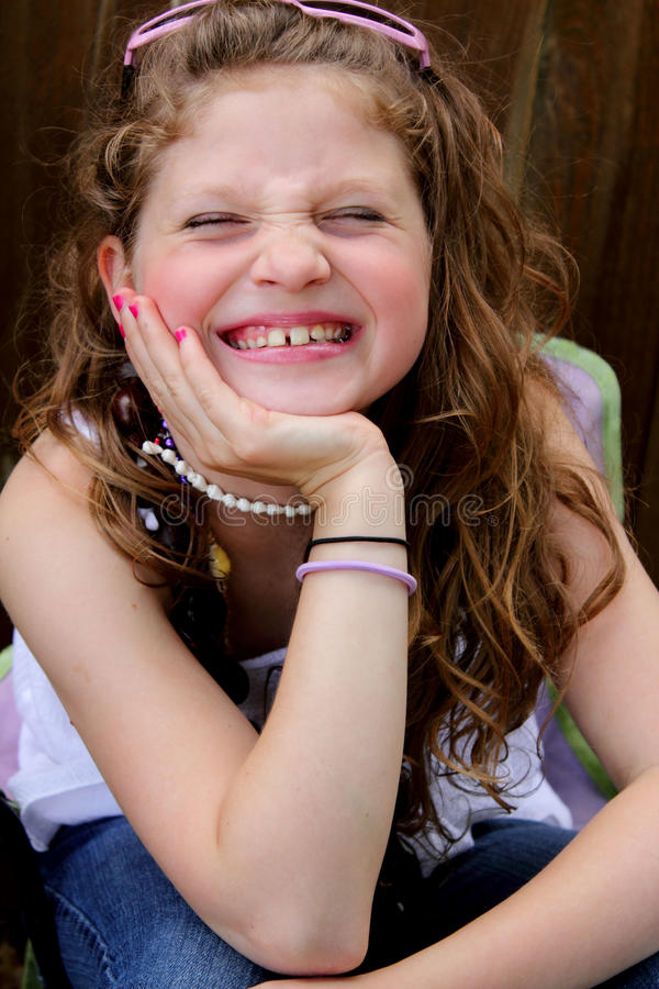 Giggling preteen girl royalty free stock images