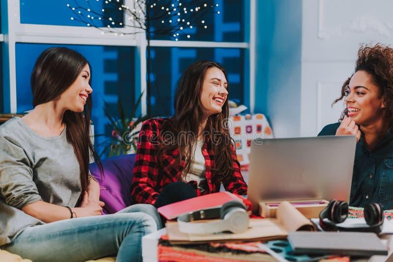 Happy three girlfriends having conversation in room royalty free stock image