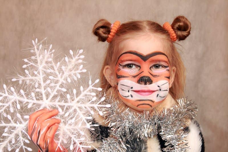 Gigl met Kerstmissneeuwvlok stock afbeeldingen