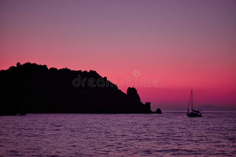 Giglio Island Sea At Dusk. Purple light at dusk over the sea at Giglio Island, Tuscan Archipelago, Italy royalty free stock image