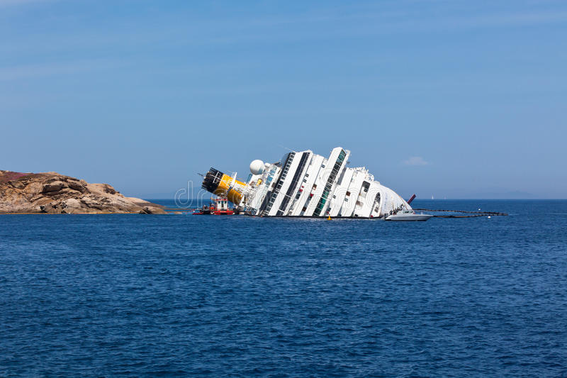GIGLIO, ITALY - APRIL 28, 2012: Costa Concordia Cruise Ship at I royalty free stock photos