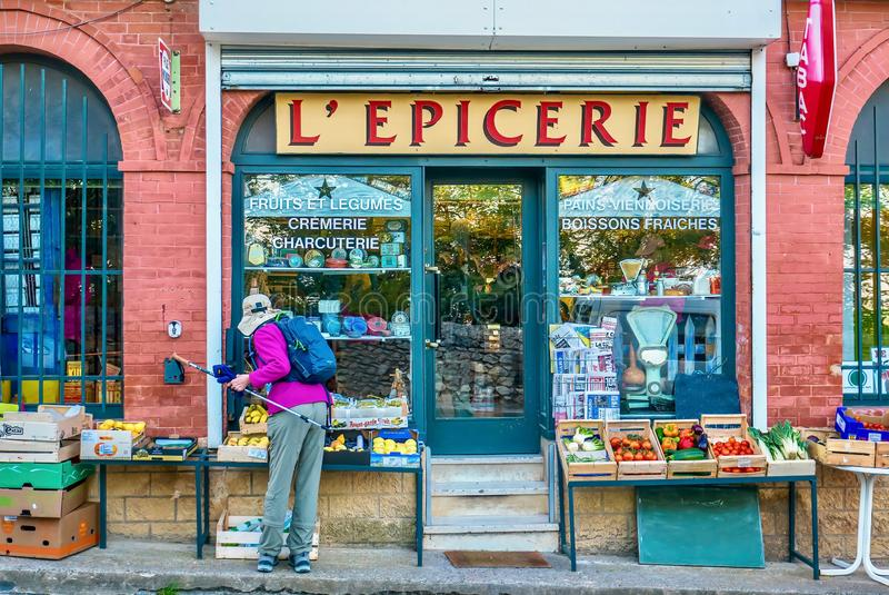 Shopping for fruit at a small grocery store in Provence, France. royalty free stock photography