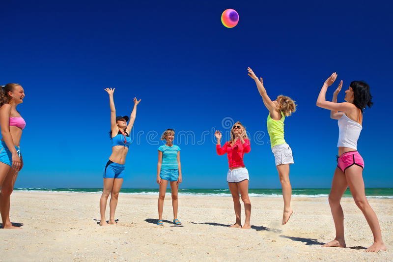 Download Giirls playing volleyball stock photo. Image of team - 34167636